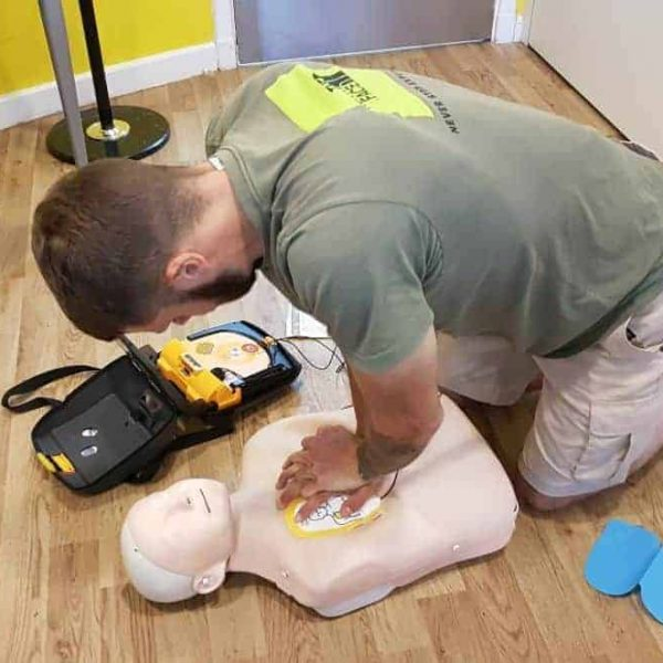Performing CPR & Defibrillation on a dummy
