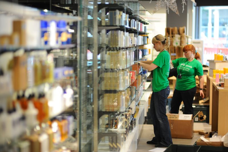 Image of someone stacking shelves in a supermarket