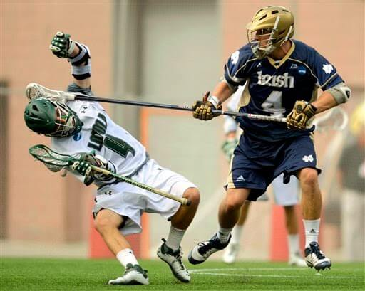 Lacrosse player striking another