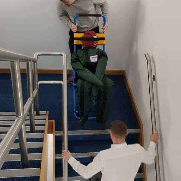 Evacuation chain in use down a flight of stairs