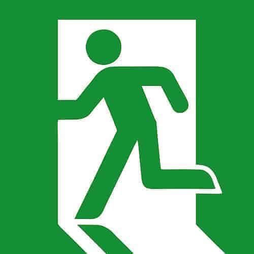 "A typical ""running man"" fire escape symbol as seen in many buildings."
