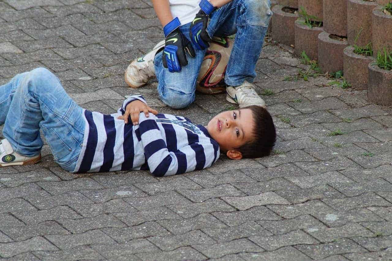 Image of a pre-teenage child lying on the floor