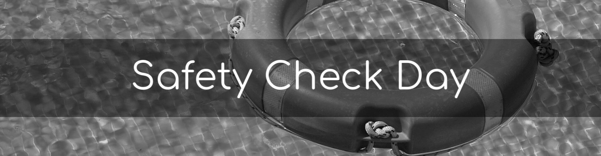 Safety Check Day - Image of a life ring floating in a pool