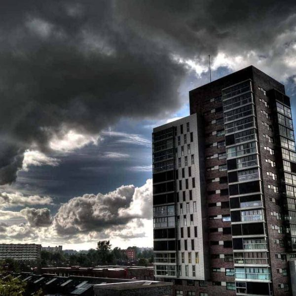 Image of an Urban High Rise Block with a moody cloud behind