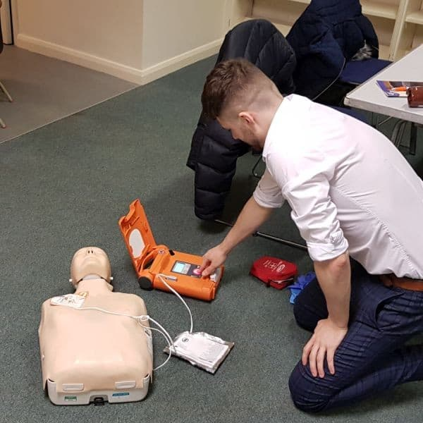 First Aid Annual Refresher Course Image of an AED being used on a training manikin